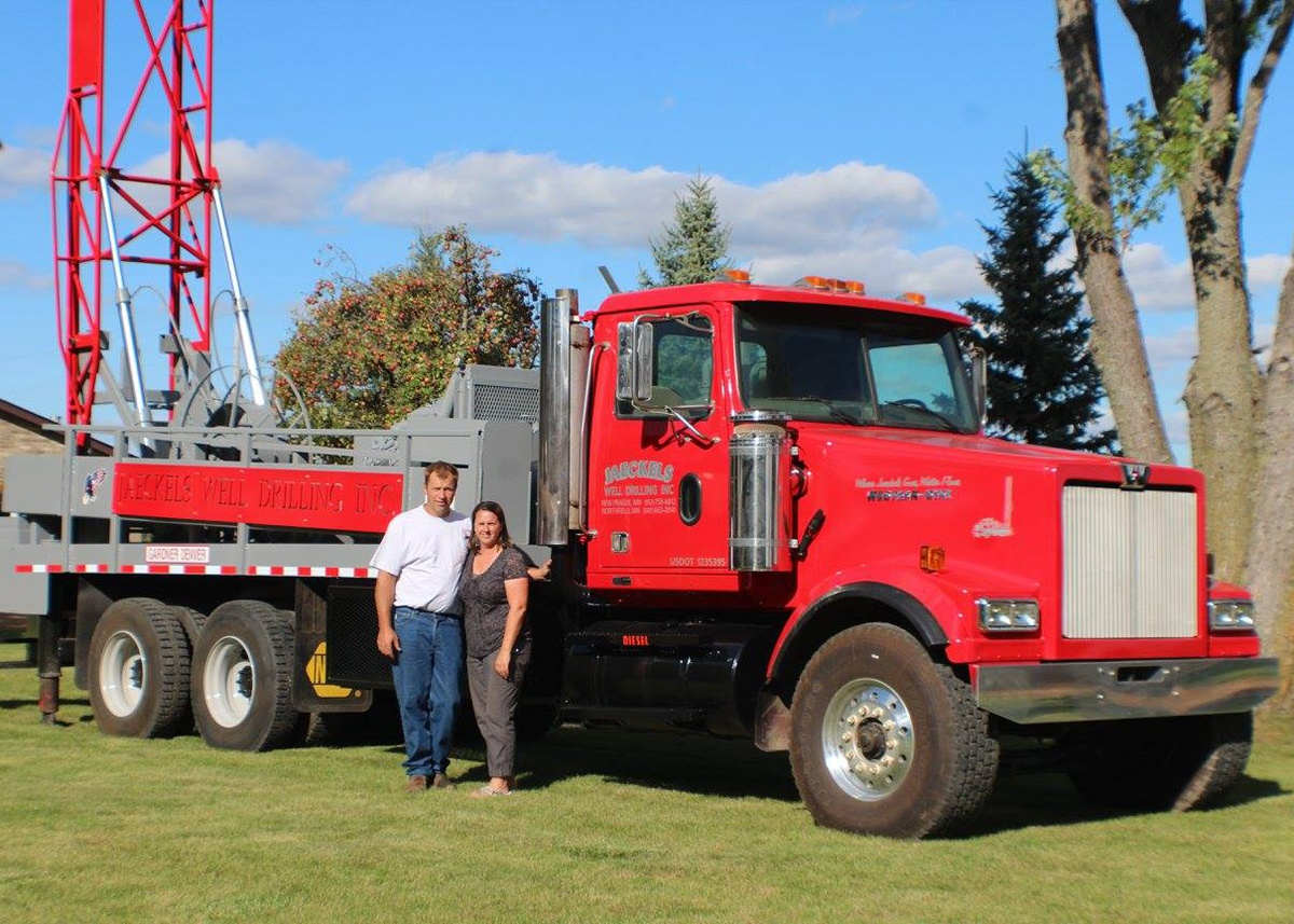 Husband and Wife in front of Jaeckels Well Drilling truck